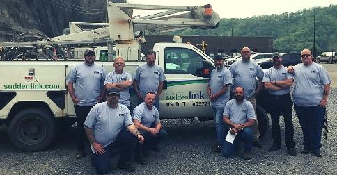 Ten Altice - Suddenlink employees in front of truck in WV.