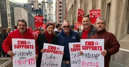 Five CWAers hold signs to support PASNAP nurses in Philadelphia, PA.