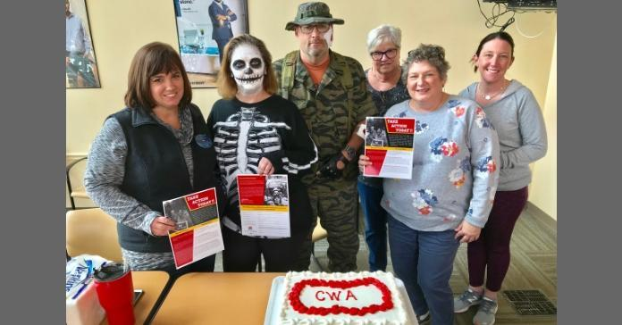 CWA Local 13500 members dressed for Halloween with Political Action flyers.