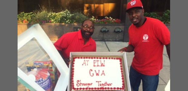 Two Local 2336 representatives with PIW-CWA cake.