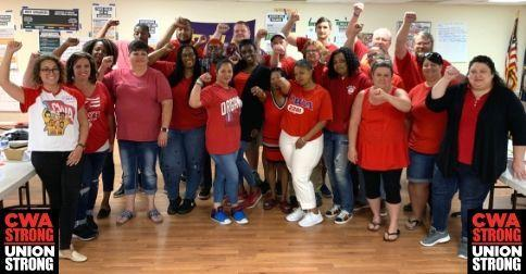 Call Center Workers in Virginia with fists in the air.